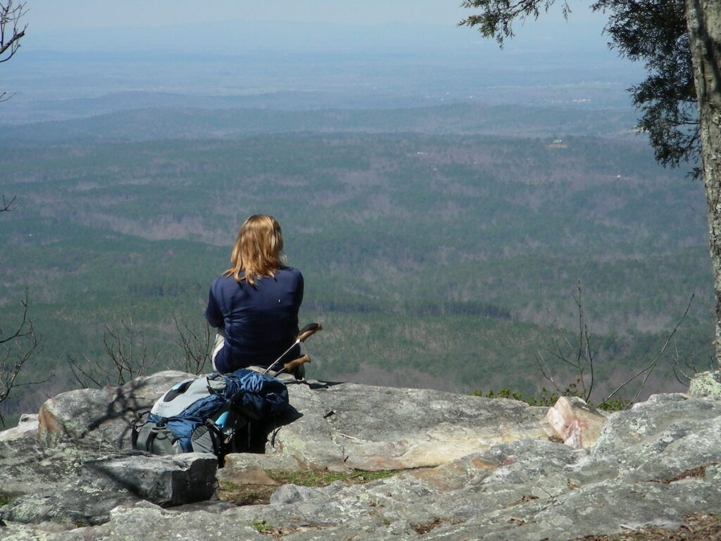 A woman enjoying the views from the Pinhoti Trail in Alabama.