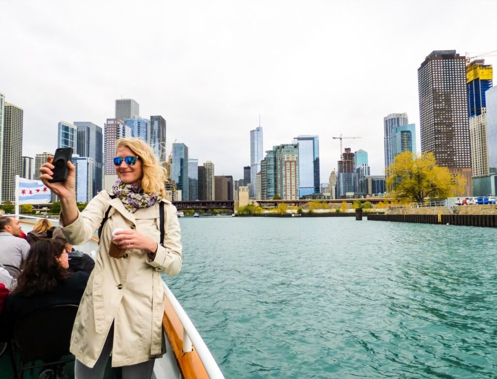A woman enjoys the Architecture River Cruise in Chicago.