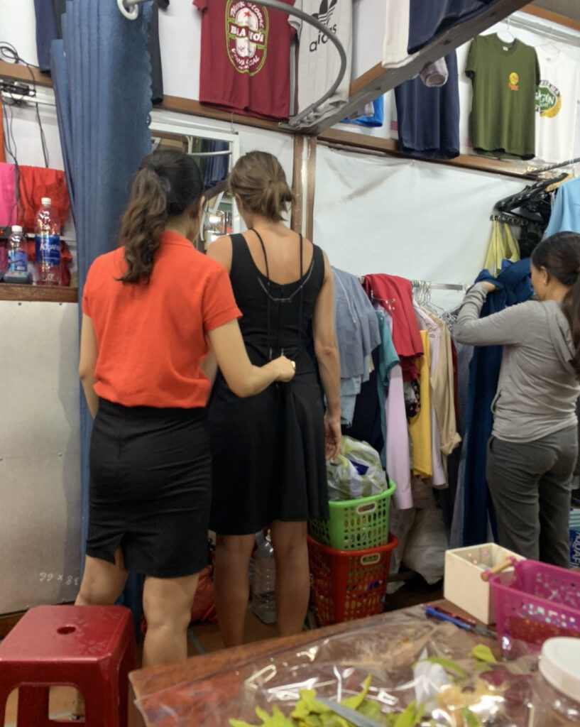 A woman gets fitted for custom clothing.