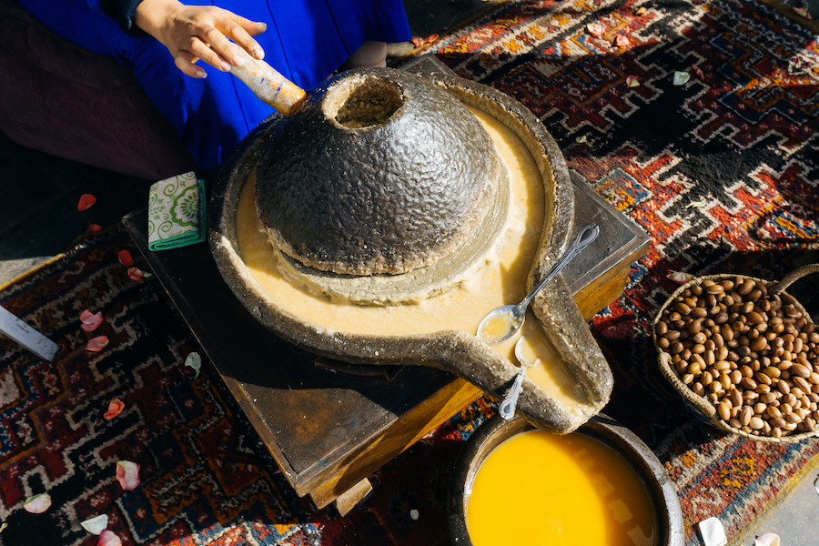 A woman making argan oil in Morocco.