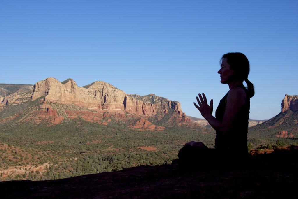 A woman meditating in Sedona.