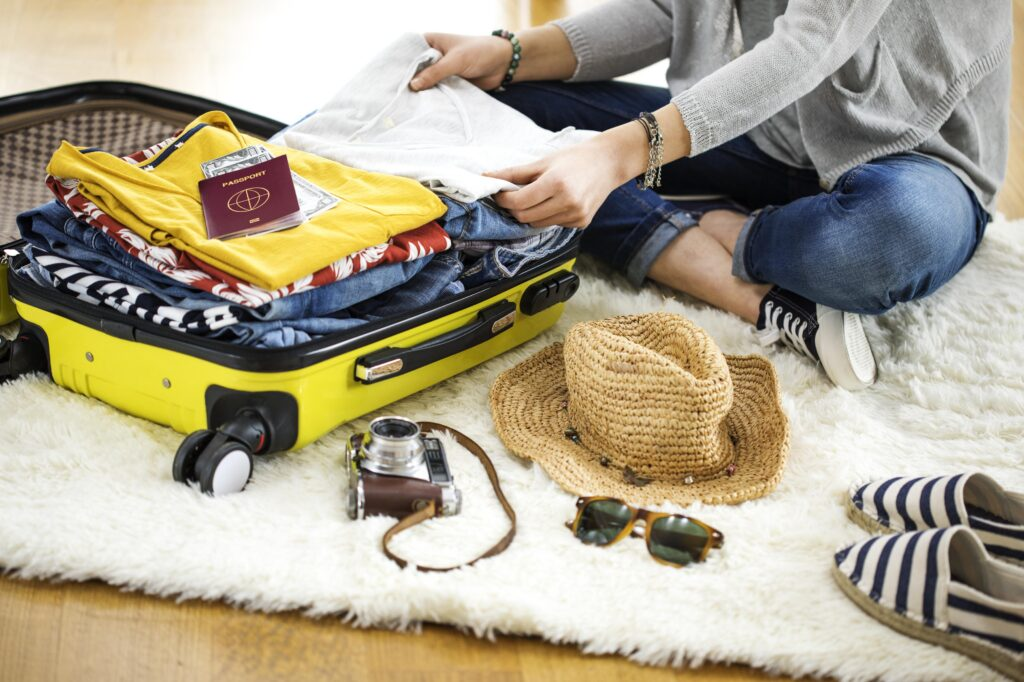A woman packing her suitcase.