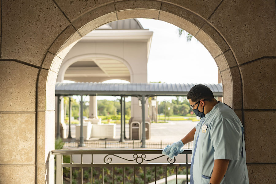 A worker at Disney World cleaning.