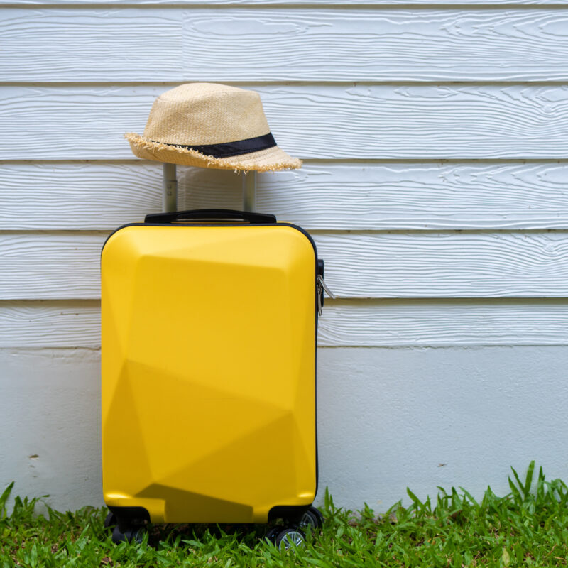 A yellow suitcase and a hat.