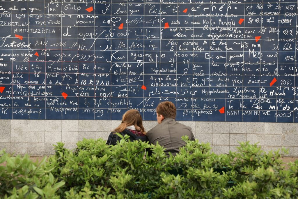 A young couple at the Wall of Love.