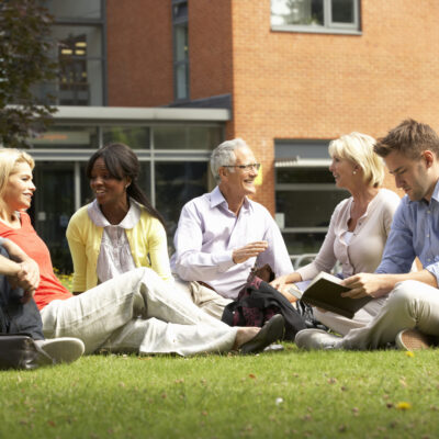 Adults learning outside.