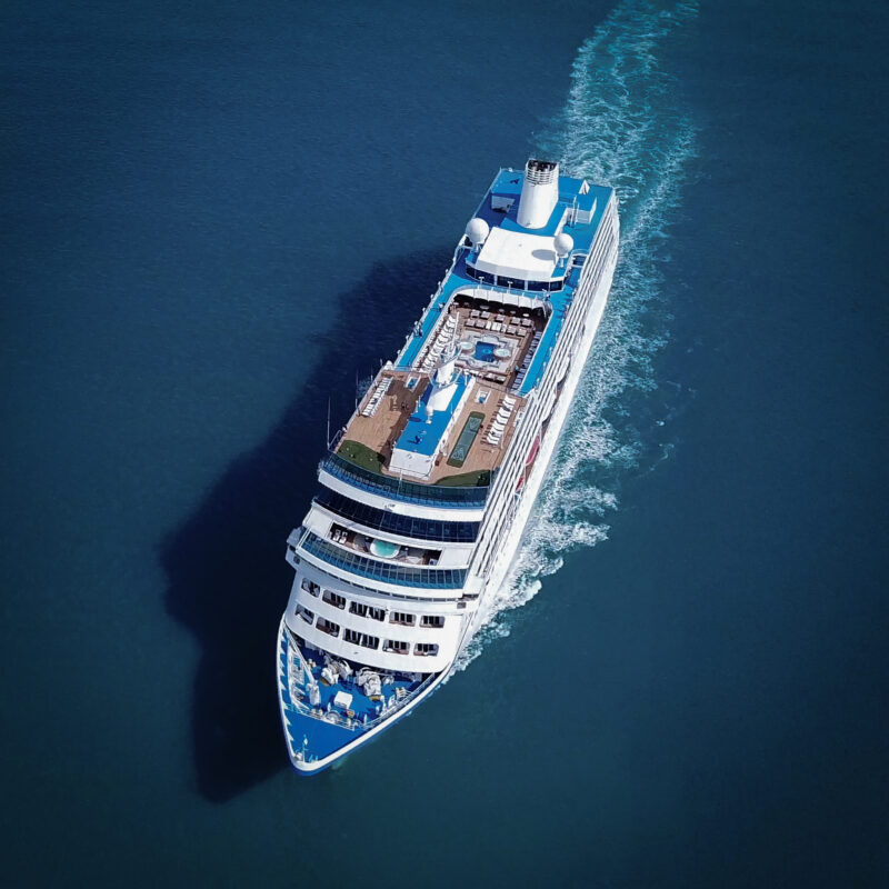 Aerial view of a cruise ship at sea.