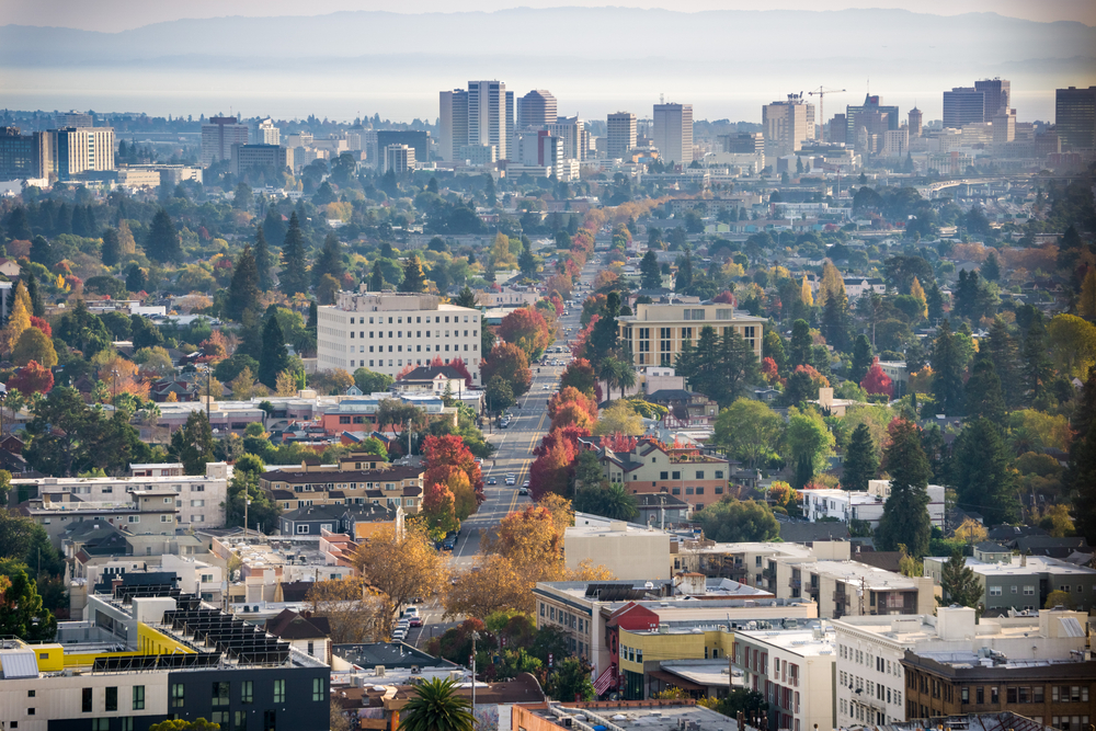 Aerial view of north Oakland on a sunny autumn evening; downtown Oakland in the background