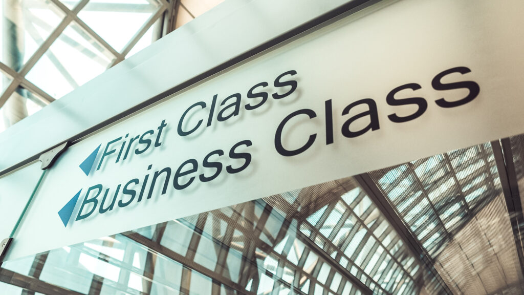 Airport signs for first and business class.