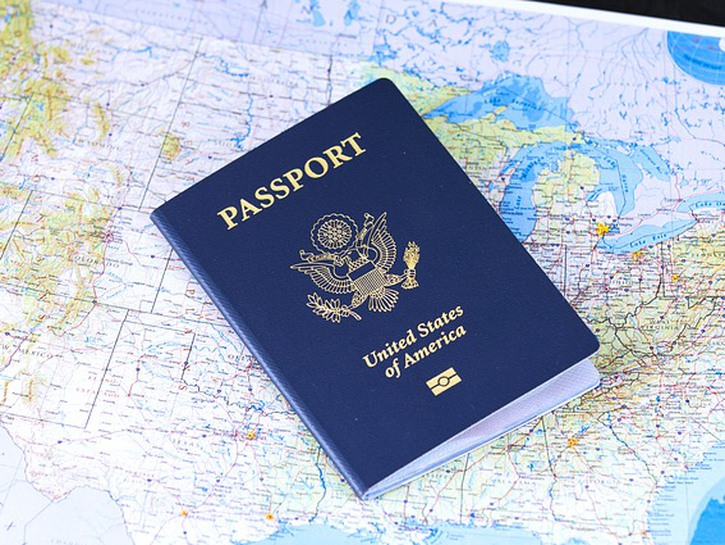 American passport on top of map of the United States
