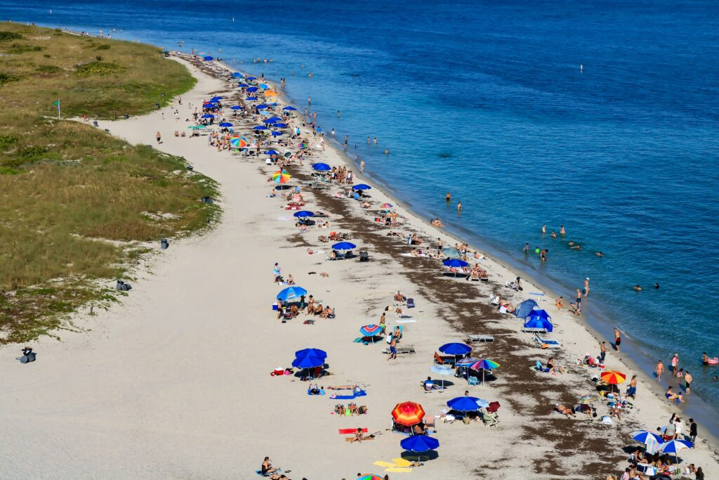 An aerial shot of sunbathers on a beach in Key Biscayne