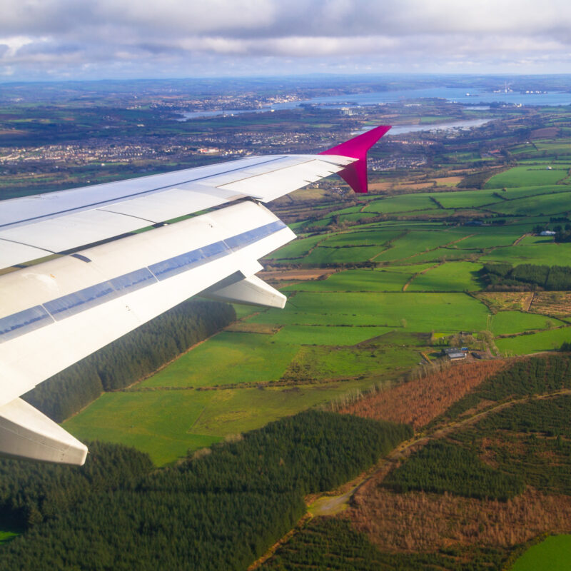 An airplane flying over Ireland.