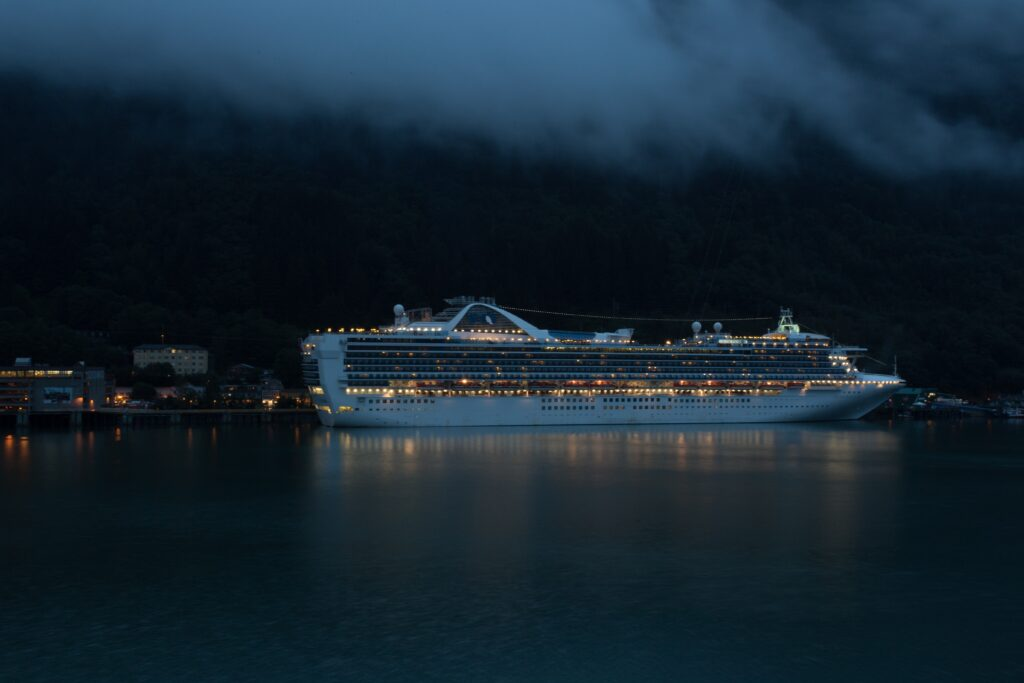 an alaksa cruise ship in a harbor at dusk