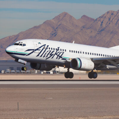 An Alaskan Airlines plane on the runway.