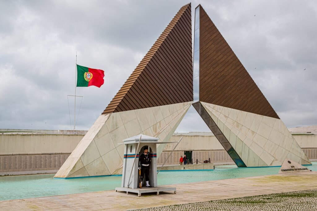 An armed guard at the Monument to Overseas Combatants.