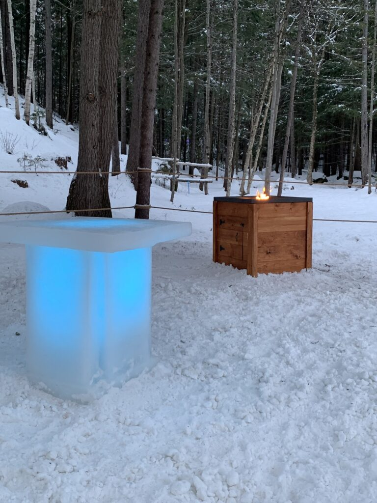 An ice table and fire at New Hampshire's Ice Castles.