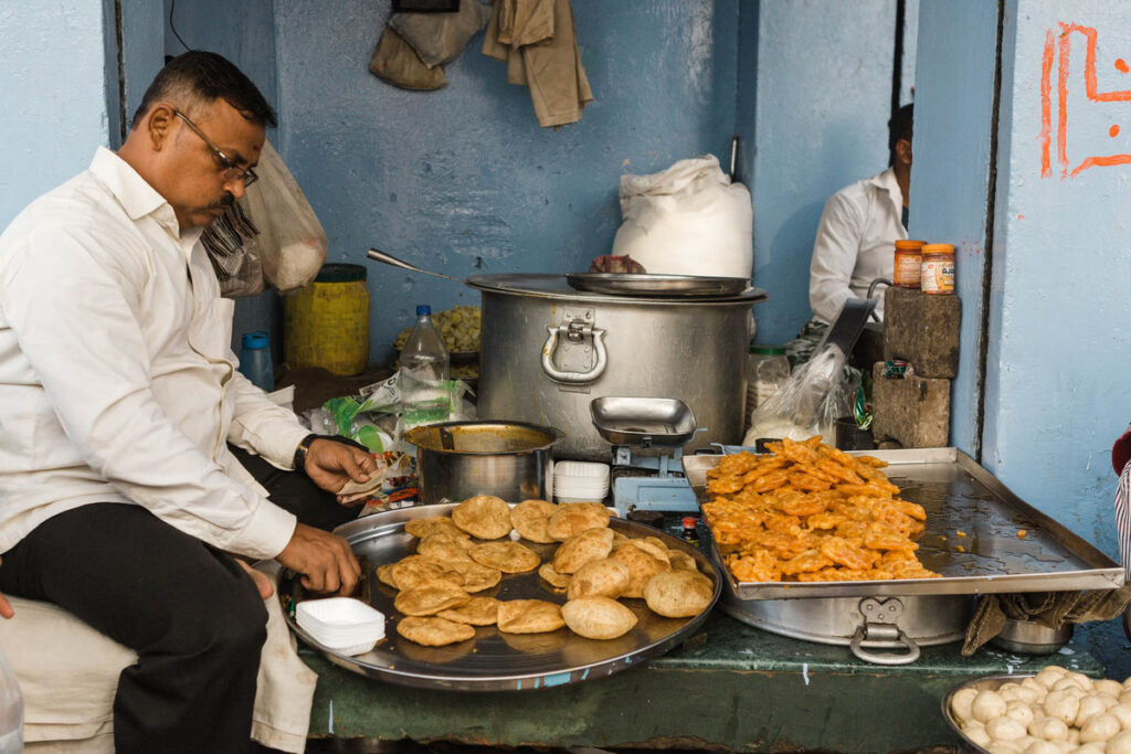 An Indian man preparing traditional street food
