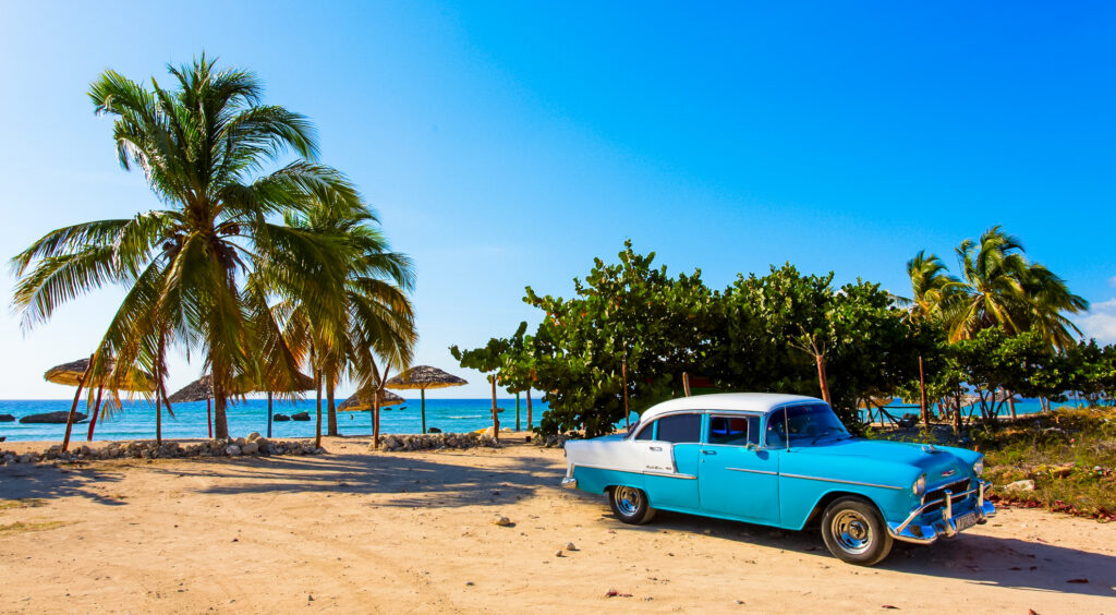 An old American car on the beach in Cienfuego, Cuba
