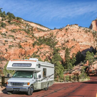 An RV driving through Zion National Park in Utah.