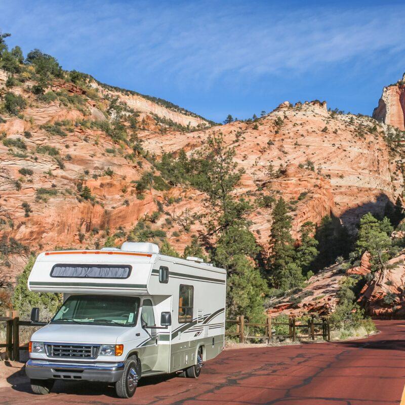 An RV driving through Zion National Park in Utah.