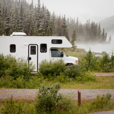 An RV parked alone in the wilderness of Alaska.
