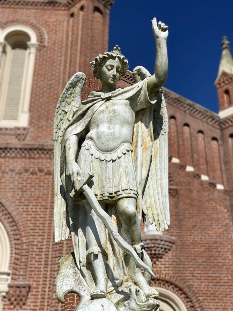 Angel statue outside a church.