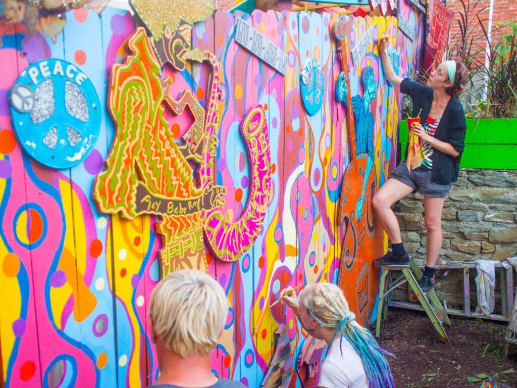 Artists painting walls at Randyland.