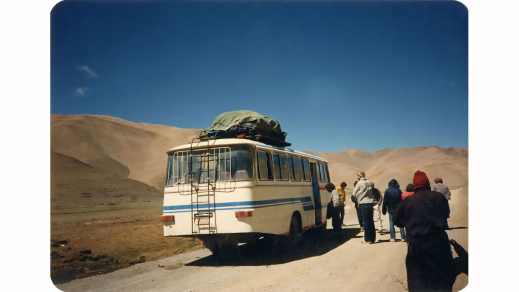 Author catching a bus in Tibet.