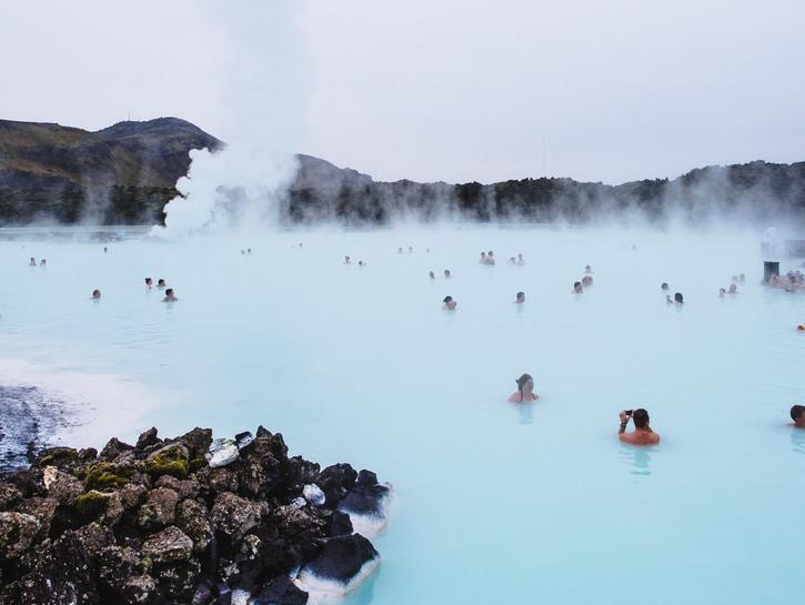 Bathers enjoying the healing waters of blue lagoon iceland