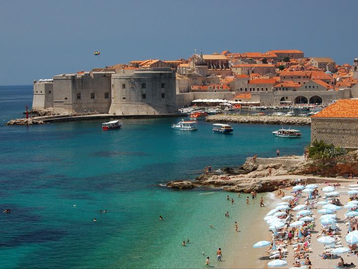 Beach and medieval walls in Dubrovnik, Croatia