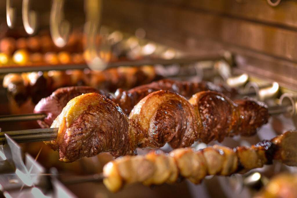 Beef being cooked at a churrascaria in Brazil.