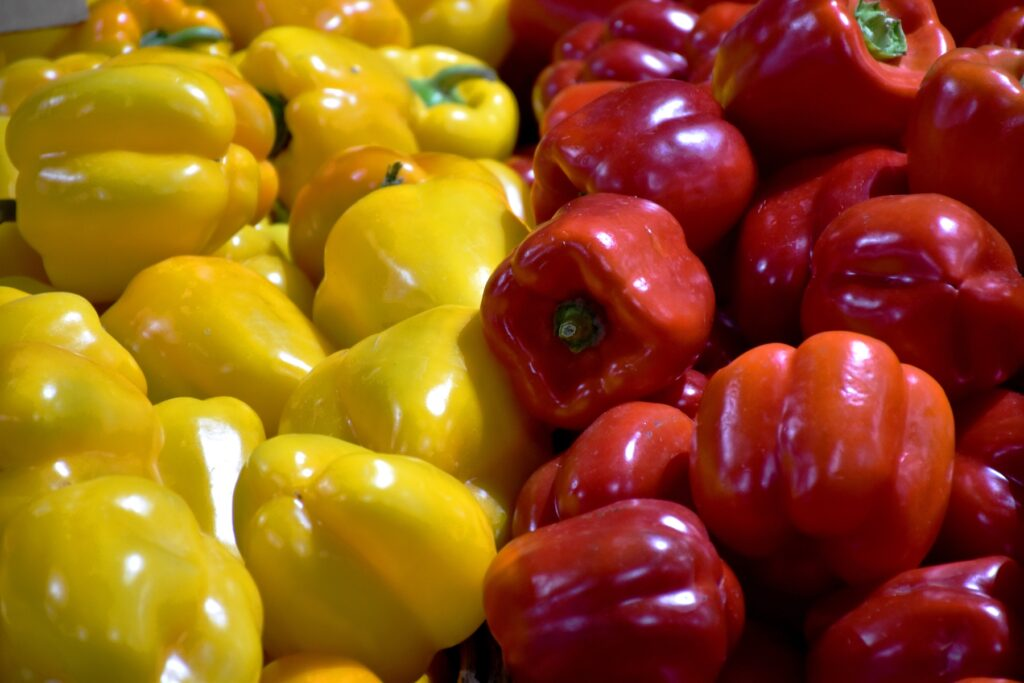 Bell peppers for sale at a market stall in Australia.