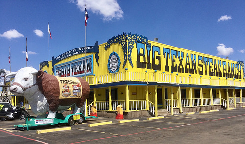 Big Texan Steak Ranch, yellow old west building, cow float parked out front Amarillo