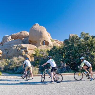 Bikers exploring Skull Rock in Joshua Tree National Park.