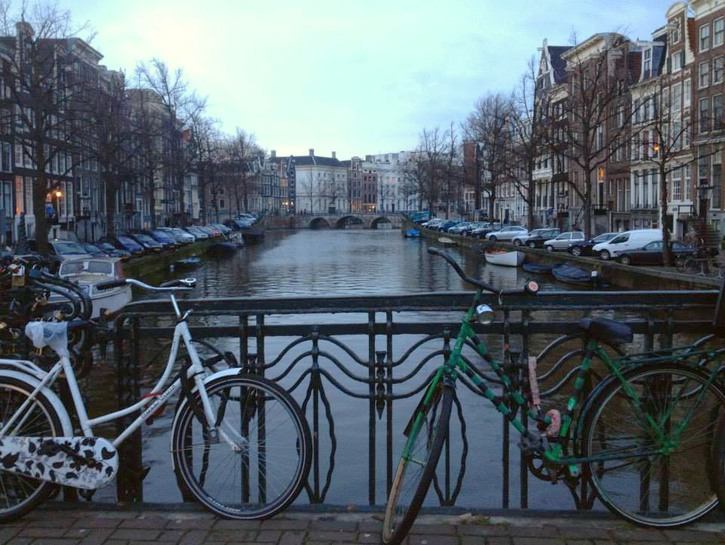 Bikes chained to bridge over canal, Amsterdam