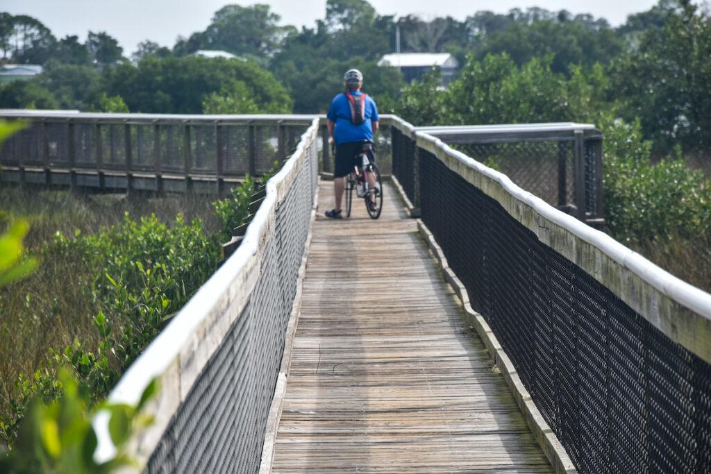 Biking on a boardwalk.