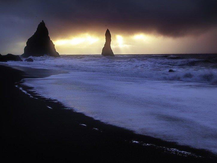 Black beach, two big rocks, storm rolling in, Iceland