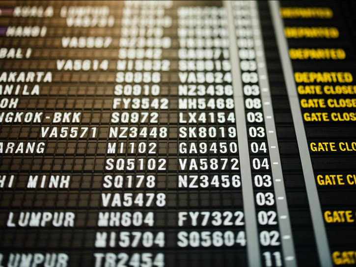 Black, white, and yellow listings of an airport departure board