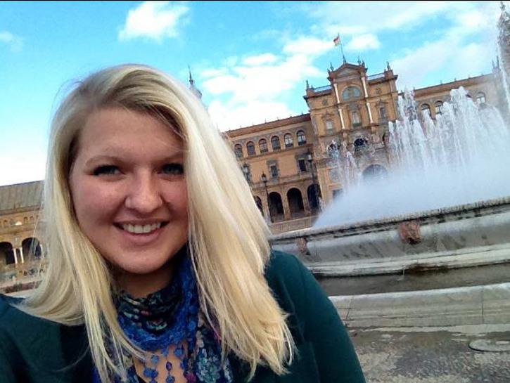 Blonde journalism student at Plaza de España, Seville.