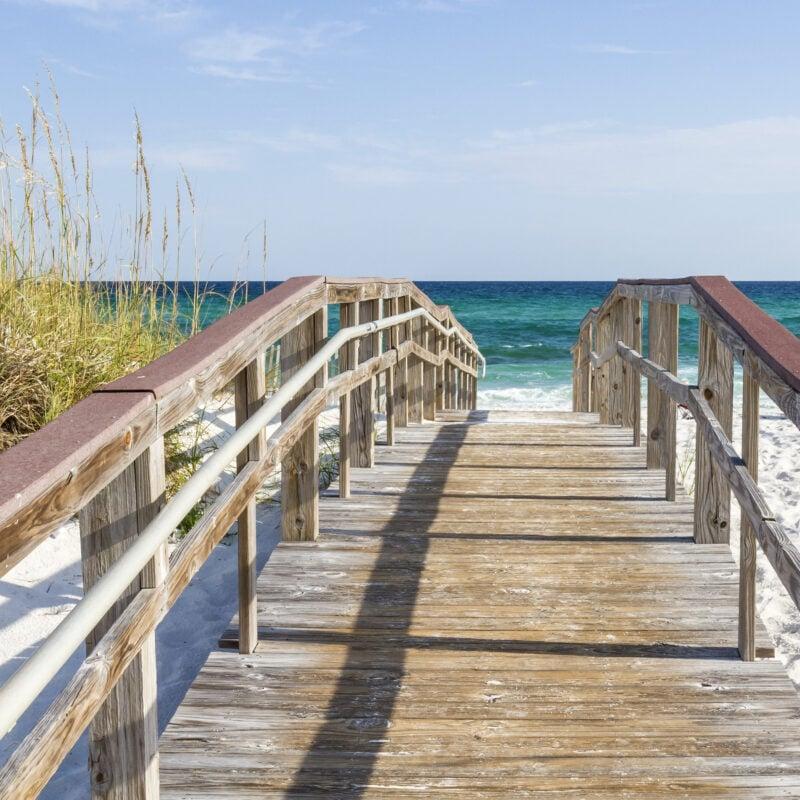 Boardwalk leading to the sea on Pensacola Beach in Florida.