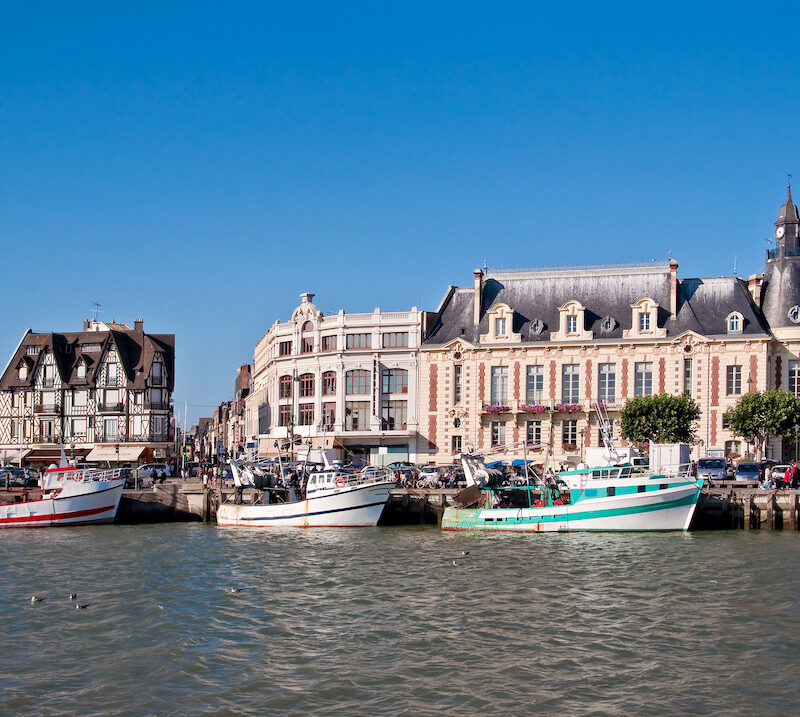 Boats by historic buildings in Trouville, Normandy, France