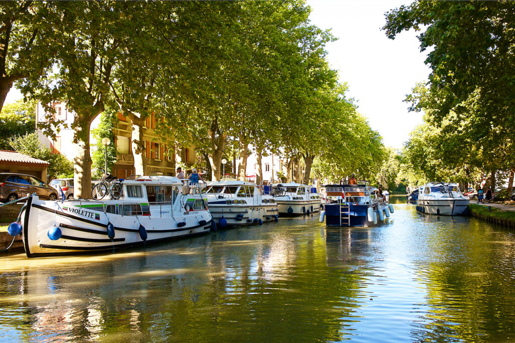 Boats on the Canal du Midi in Carcassonne.