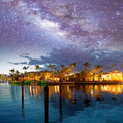 Boca Raton, Florida, with a starry sky above.