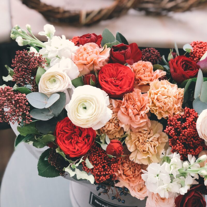 bouquet of red, coral, and cream flowers
