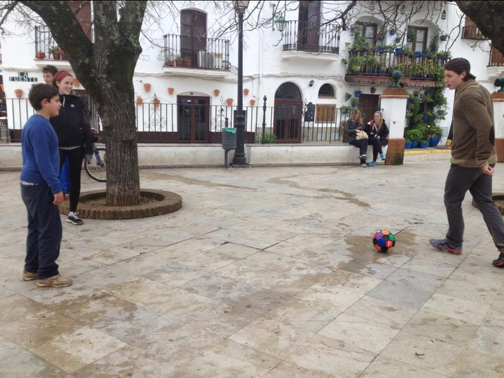 Boys playing with soccer ball in the streets of Seville, Spain.