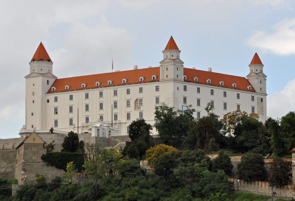 Bratislava Castle: White building with red roof and trees in the foreground