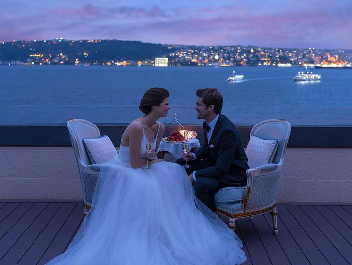 Bride and groom on terrace of the Shangri-La Suite, Shangri-La Hotel, Istanbul