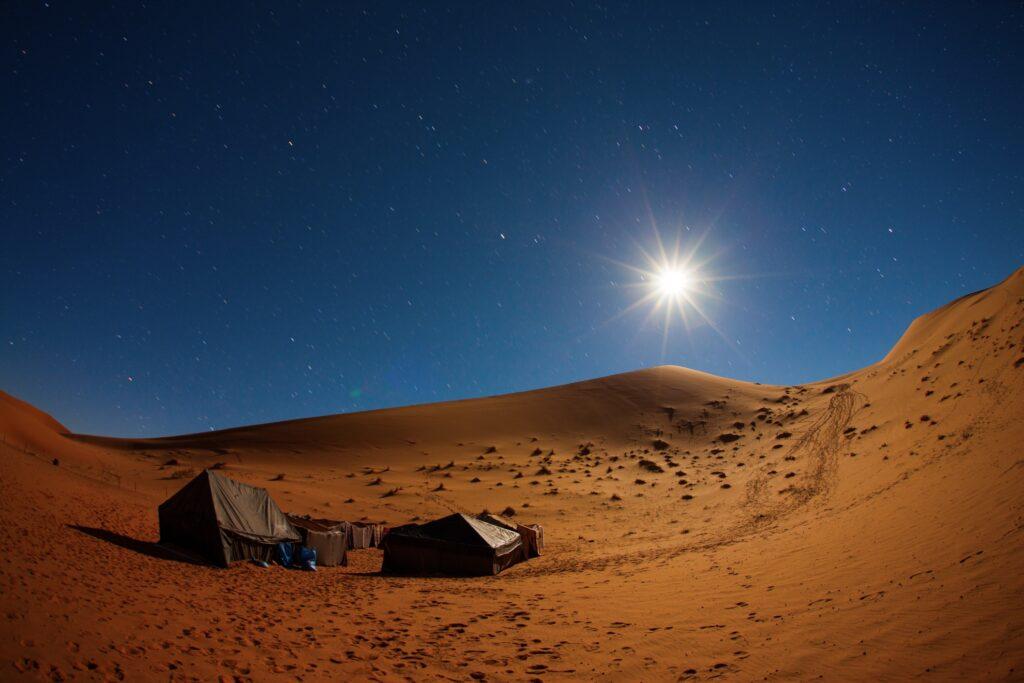 Camping under the stars in the Sahara Desert.