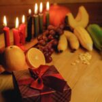 Candles and fruit decorations for Kwanzaa.
