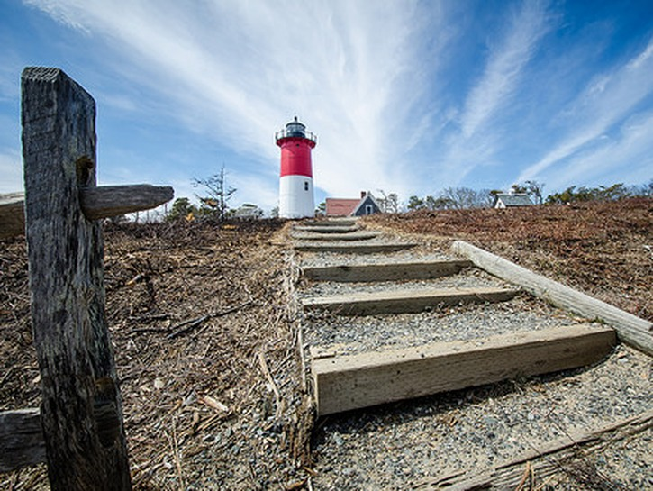 Cape Cod stairs with lighthouse